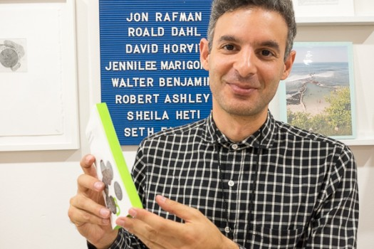 Jeff Kohnsary of The Future, Vancouver, BC, holds a book with foreedge, top and bottom colored bright green.