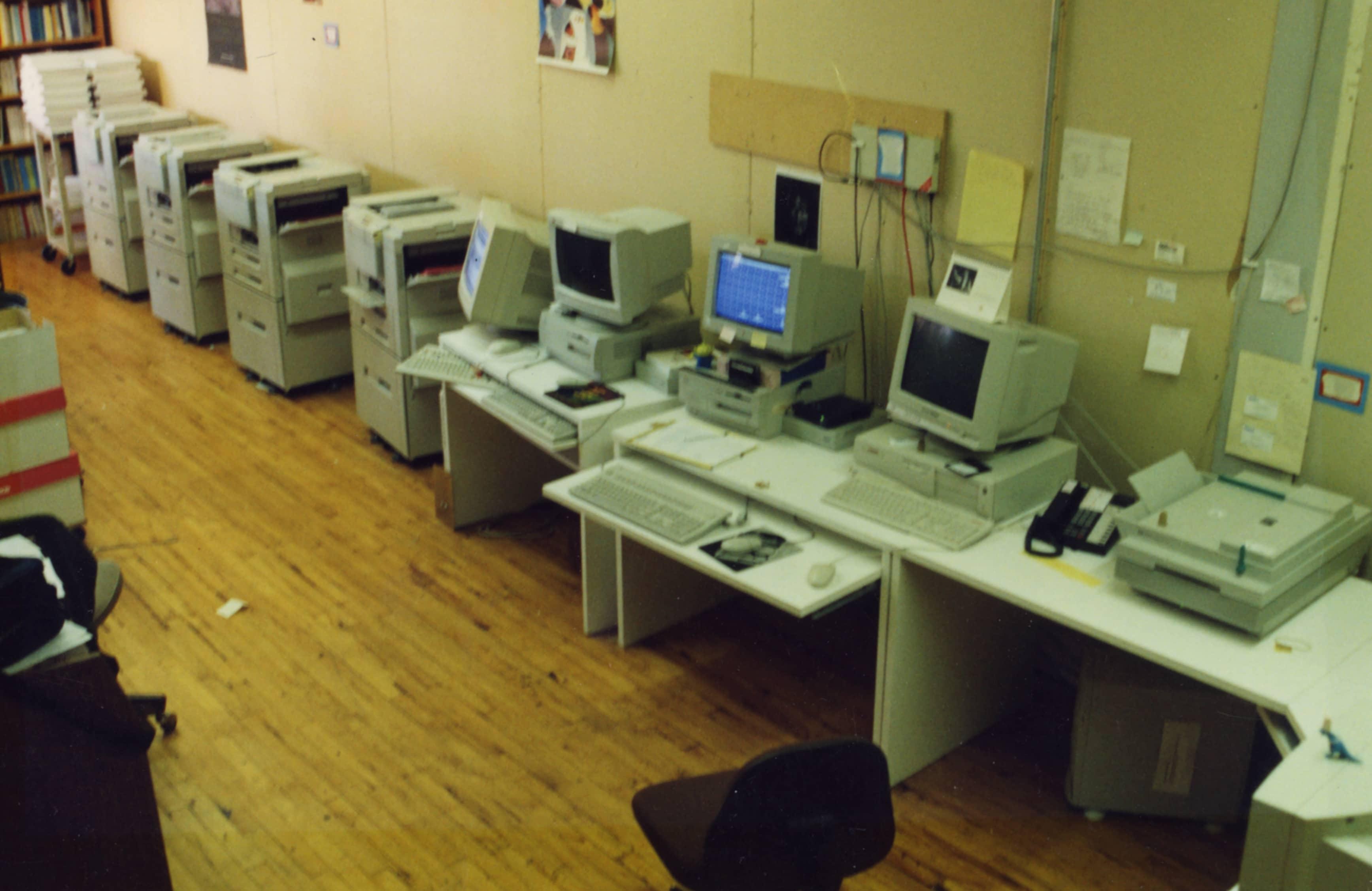 Row of cluster printers in our first printshop in Saint Paul, 1997.