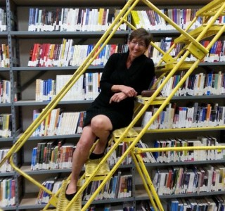 Sue Petrie in front of our archive library during her visit.