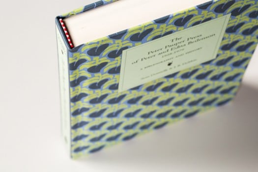 This is a squareback hardcover in which the case cover has been printed. Note the red and white headband.
