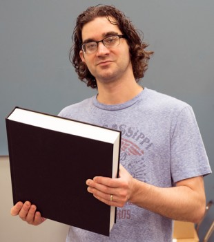 Tony Houle, our bindery supervisor, holds a giant test book bound on our new PUR perfect binder and cased in.