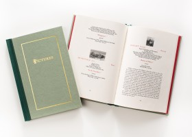 This book has a three-piece case with a contrasting spine cloth, as well as a large foil stamp on the front cover.